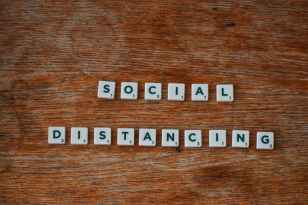 social distancing on wooden table